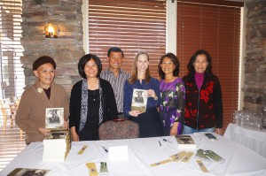 Attending the book talk are some of the people who are in the book, from left, Rose Le, Nancy Hue La, Luong La, Michelle Robin La, Young La Milton, and Lisa Tuyet Le. Rose Le is the mother of Luong, Young, and Nancy while Lisa Tuyet Le is their aunt.