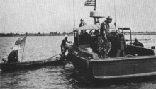 River Patrol Boat stops a small Vietnamese boat. River patrol boat on the Mekong Delta. Photo from the U.S. Navy All Hands magazine July 1969.