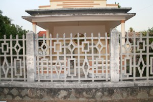 Graves in front of a house in Quới Sơn.