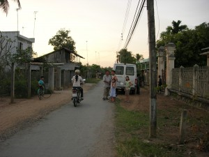 A road through a small town in the Mekong Delta.