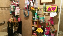The ladies room in a Little Saigon restaurant has fresh flowers and is stocked with personal grooming items like razors, facial wipes, deodorant, and make-up.